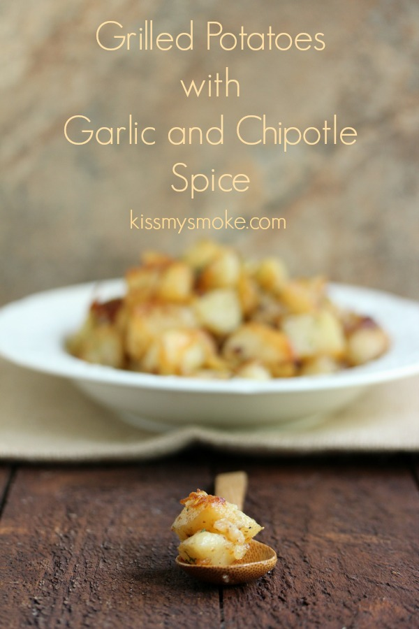 Grilled Potatoes with Garlic and Chipotle Spice | kissmysmoke.com | Grilled Potatoes roasted in a pan with butter, fresh garlic, red pepper dressing, and just a hint of chipotle spice to add a little heat.