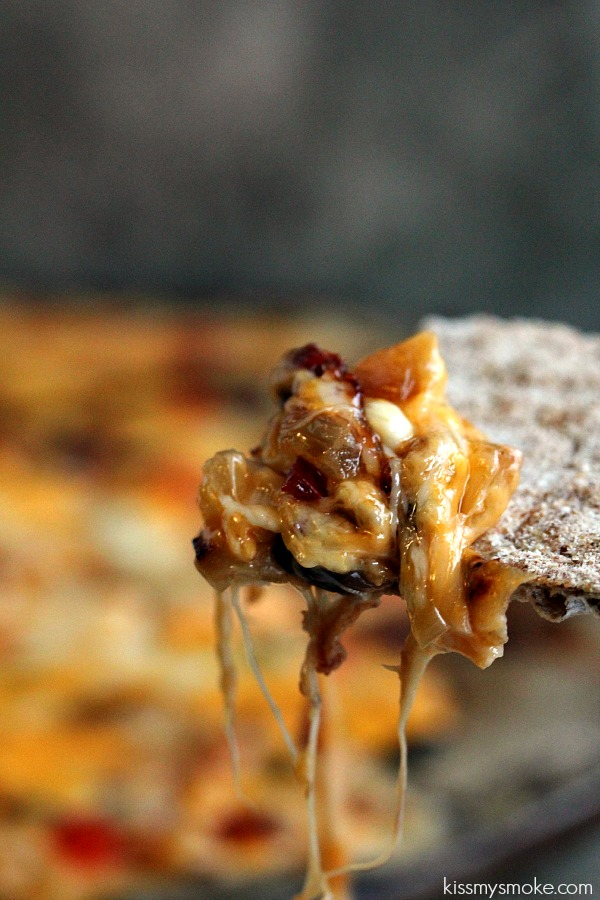 Cheesy Melt   Kiss My Smoke   This is one serious recipe to get your friends dunking for the big game.