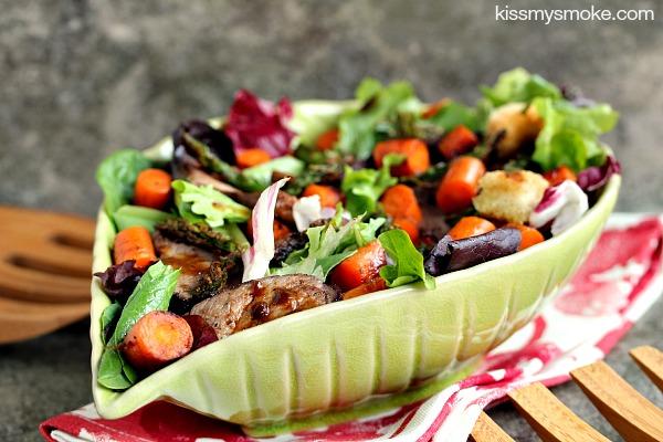 steak salad served in a green bowl