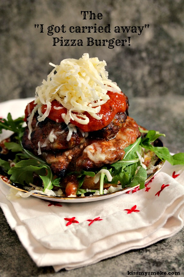 Grilled Pizza Burger that is stuffed with pizza mozzarella and loaded with sauce and toppings!