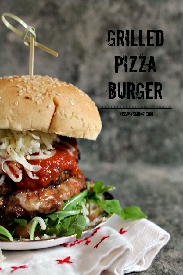 Grilled Pizza Burger stuffed with pizza mozzarella and topped with amazing ingredients!