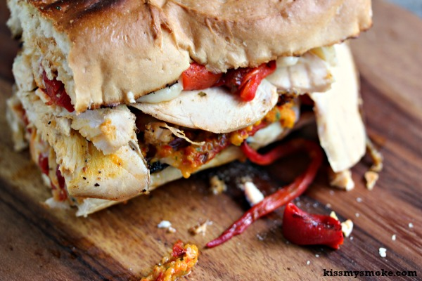 Grilled Smoked Chicken Sandwich with Roasted Red Peppers, Mozzarella, and Red and Yellow Pepper Pesto | kissmysmoke.com | This sandwich is so over the top good. I smoked a chicken, then sliced it up, then turned it into a grilled chicken sandwich layered with roasted red peppers, mozzarella and fire roasted yellow and red pepper pesto!
