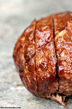 Grilled Meatloaf covered in sauce.