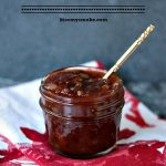 Bacon Barbecue Sauce served in a mason jar with a spoon in it