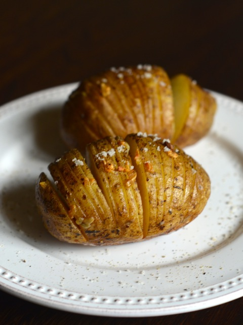 Garlic Hasselback Potatoes on the Grill: Guest Post by CopyKat Recipes on kissmysmoke.com | Potatoes are cut into small slices, then drizzled with garlic butter sauce. It gives an amazing crunch to these potatoes!
