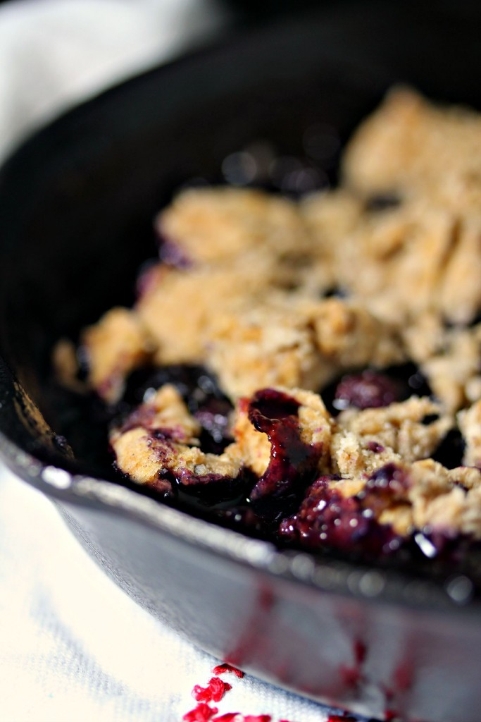 Grilled Blueberry Cobbler- Blueberry Cobbler is the highlight of any summer meal. You can easily make it on the grill to keep your house cool this summer! Get the recipe at kissmysmoke.com