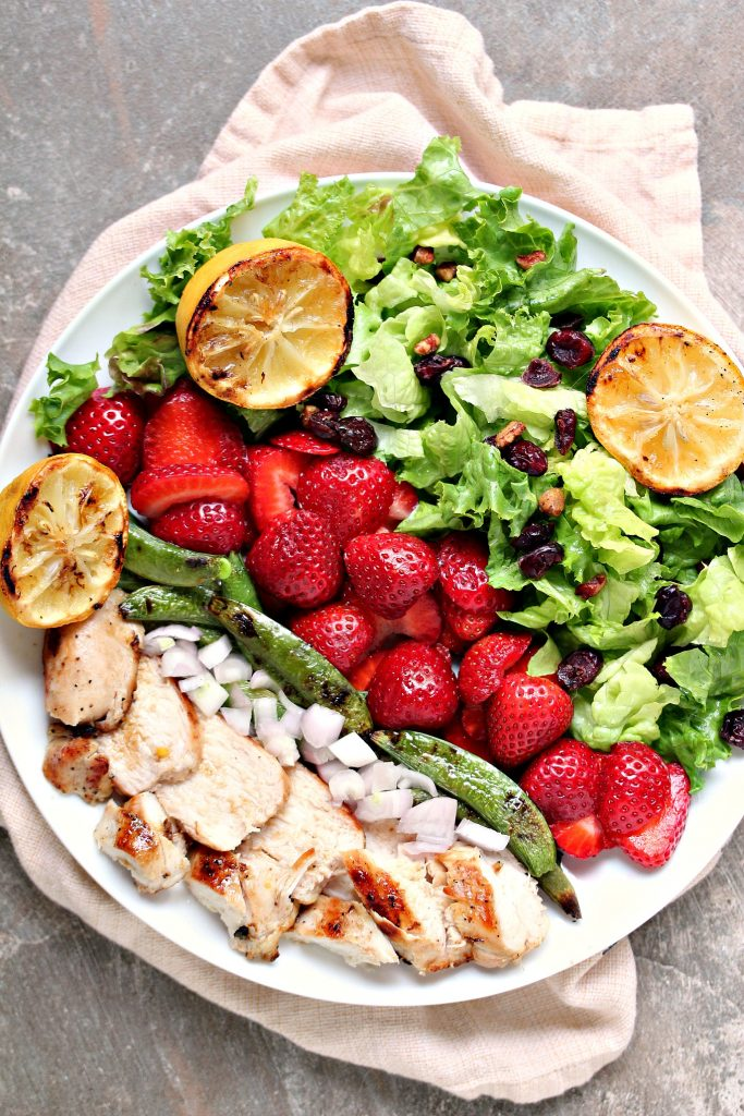 Grilled Chicken Salad and Strawberries from kissmysmoke.com- This grilled chicken salad can be prepared quickly and adapted to your tastes. You can use fresh strawberries, or frozen. Just don't skimp on the add-in's.