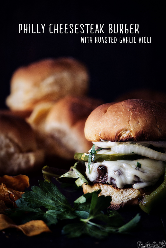 Philly Cheesesteak Burger Recipe with Roasted Garlic Aioli from Girl Carnivore- featured on 15 Kick-Ass Grilling Recipes by kissmysmoke.com- These 15 Kick-Ass Grilling Recipes are for die-hard grill lovers. Grilling is a way of life for serious grillaholics. These recipes were hand-picked for those people who love the process as much as the end result!