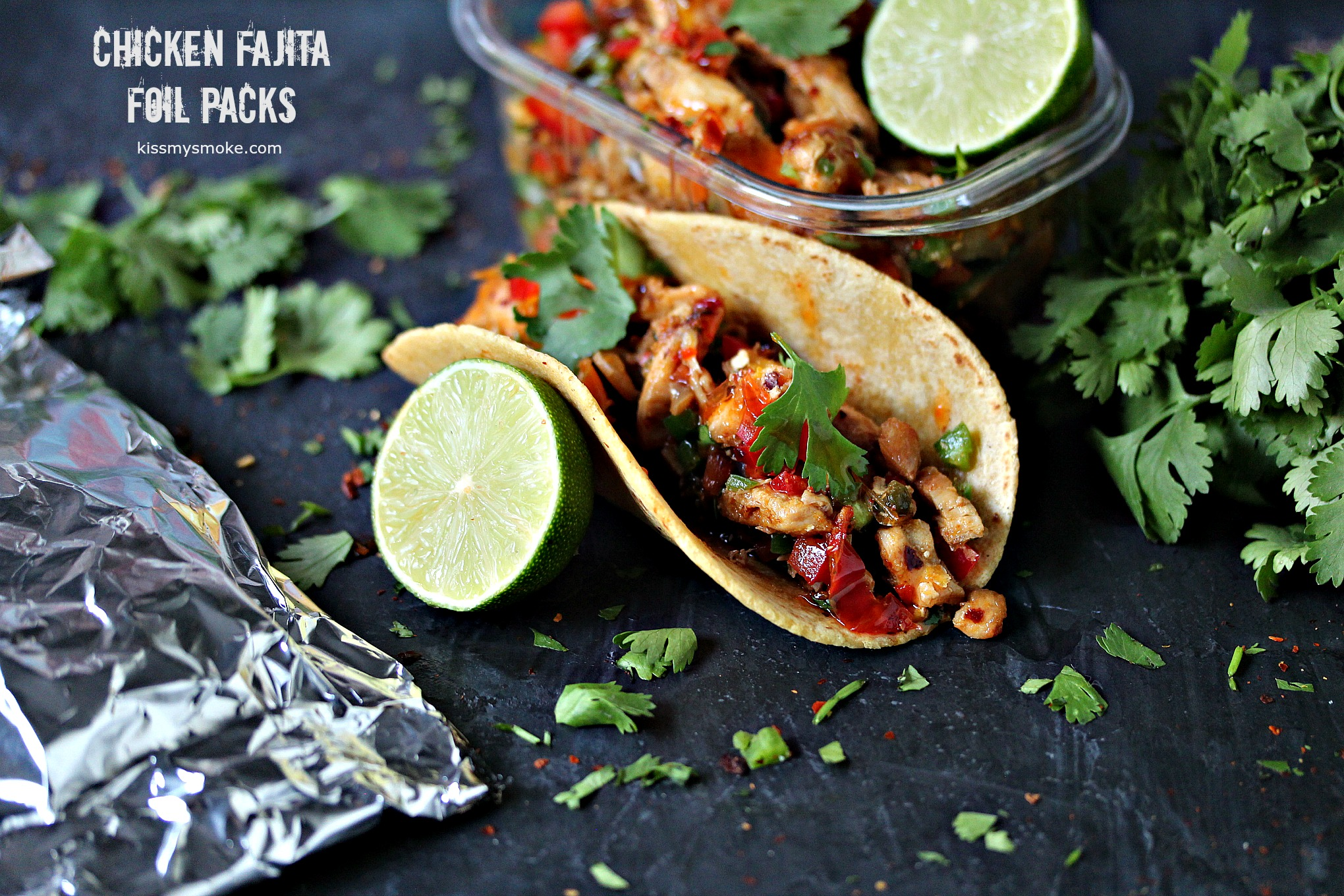 Grilled Chicken Fajita Foil Packs from kissmysmoke.com- These quick and easy chicken fajitas are cooked in foil packs to make cleanup a snap. Make extra foil packs and your weekly meal prep is done!
