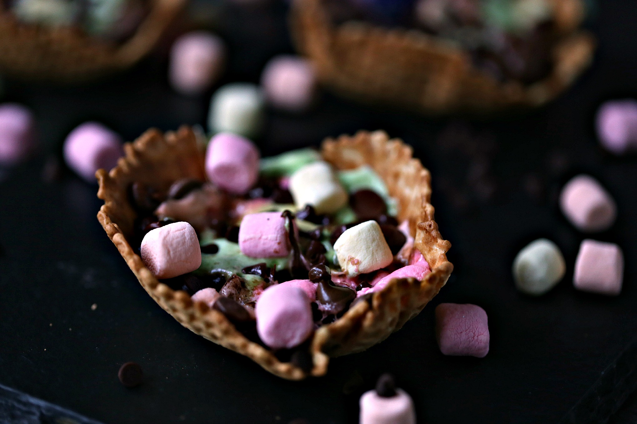 close up image of S'mores Campfire Waffle Cups with lots of chocolate and marshmallows